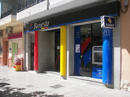 el banco de santander planea comprar banesto y cerrar